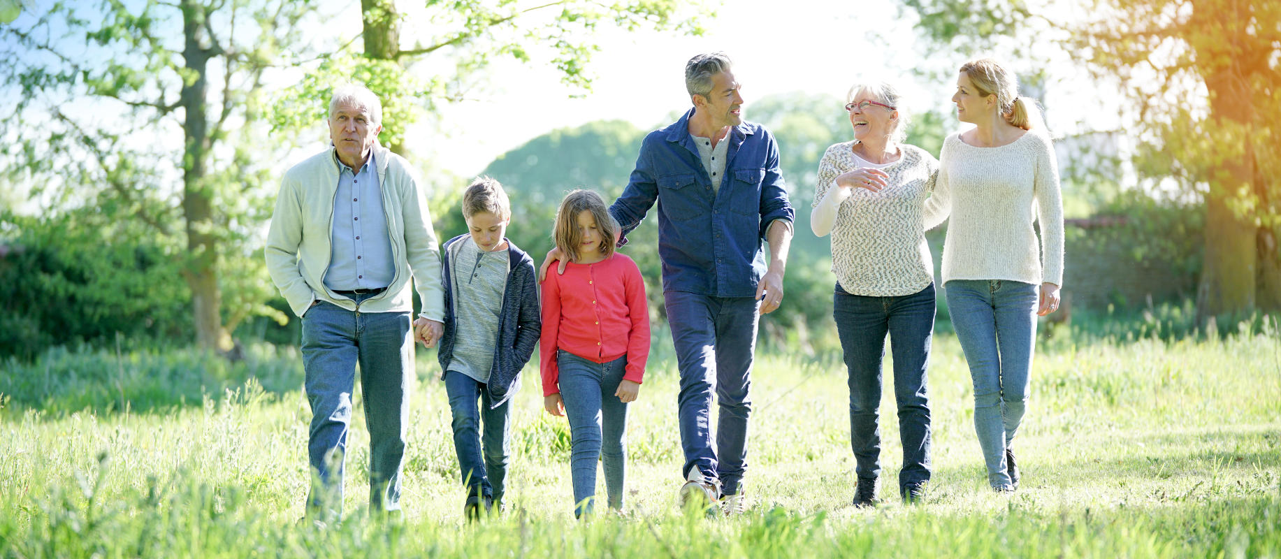 NaturalFit; Dentures & Denture Care: About Us Page: Family Walking in Field