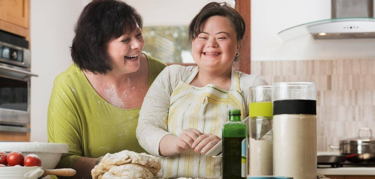 Host Home Parent and Girl Having Fun Cooking: Together We Shine LLC Host Home Family Matching and Respite Care Programs for Caregivers and People with Disabilities