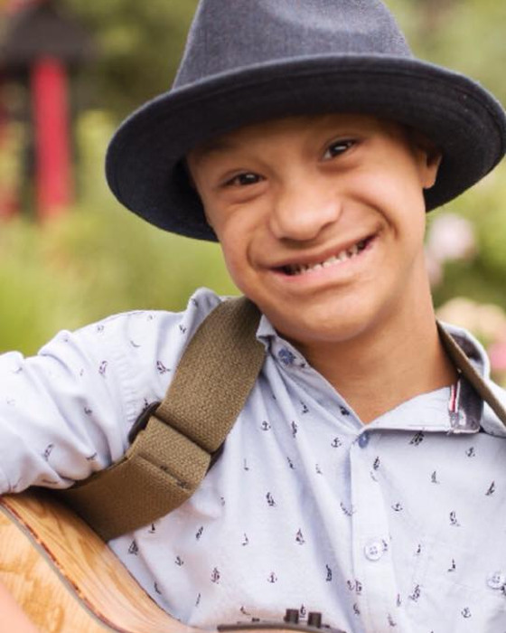 Photo of Boy with Down Syndrome; Become a Host Home Family for an Individual with a disability